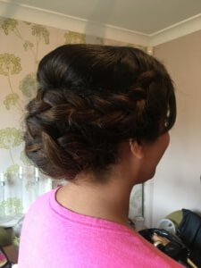 Side picture of hair style. Braided updo.
